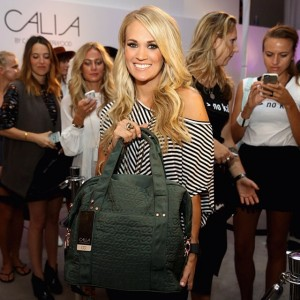 Carrie Underwood showing a piece from the Fall:Winter collection of Calia by Carrie